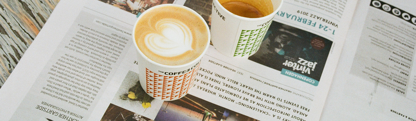 Photo of two cappuccinos on a newspaper