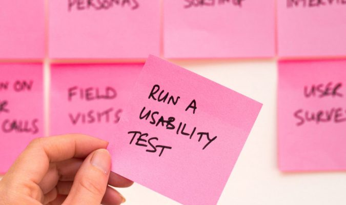"Photo of a post-it with the text ""runa a usability test"""