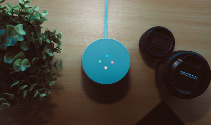 Photo of a Google Home and lenses on a table