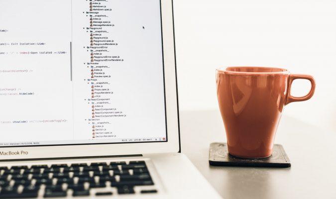 Photo of a laptop and a mug