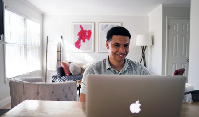 Photo of a man using a laptop